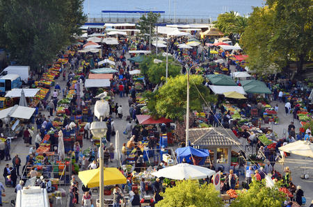 Kavala, Greece - September 22nd 2012: Crowd of unidentified people and market stalls on the weekly street market for fruits and vegetables Editorial