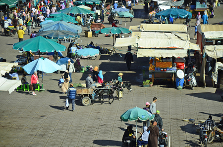 preferred: Marrakesh, Morocco - November 23rd 2014: Unidentified people on Djemaa el-Fna, Unesco world heritage site and preferred place for tourists and inhabitants