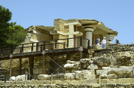 minoan: Knossos, Greece - May 26th 2014: Unidentified tourists by sightseeing of the ancient Minoan palace in Crete, a tourist attraction and archeological site of bronce age