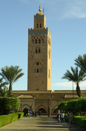 tourist attraction: Marrakesh, Morocco - November 23nd 2014: Unidentified people and Koutoubia mosque, landmark and tourist attraction Editorial