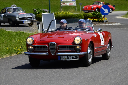 romeo: Lunz am See, Austria - July 19th July 2013: Vintage car Alfa Romeo Spider by yearly motorsport event Ennstal Classic on Public Roads Editorial