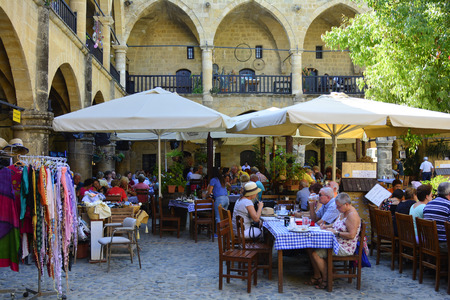 khan: Nicosia, Cyprus - October 20th 2015: Unidentified people in restaurant inside the Great Khan building