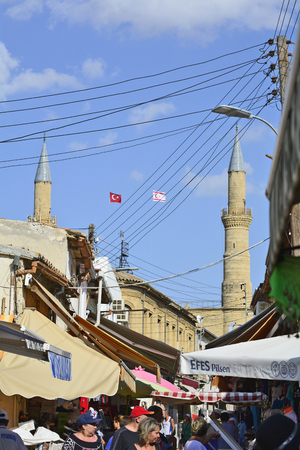 selimiye mosque: Nicosia, Cyprus - October 20th 2015: Unidentified people in small streets of the pedestrian precinct and minarets of Selimiye mosque in background