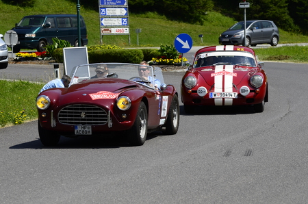 ac: Lunz am See, Austria - July 19th 2013: Vintage car AC Ace and Porsche 356 on Public Roads by Ennstal Classic Rally