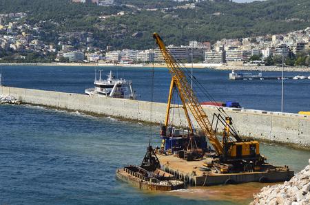 dredging: Greece, Kavala, crane dredging in the harbor