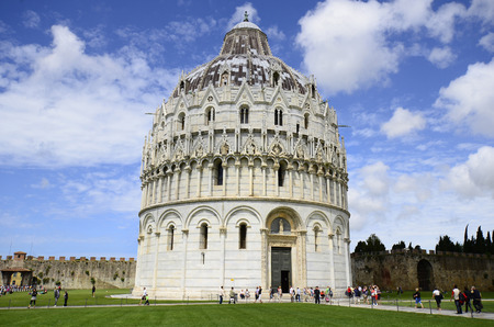 miracoli: Pisa, Italy - June 11th 2012: tourists visit impressive Battistero di San Giovanni on Piazza dei Miracoli Editorial
