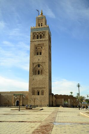 tourist attraction: Marrakesh, Morocco - November 23rd 2014: Unidentified people and Koutoubia mosque, landmark and tourist attraction Editorial