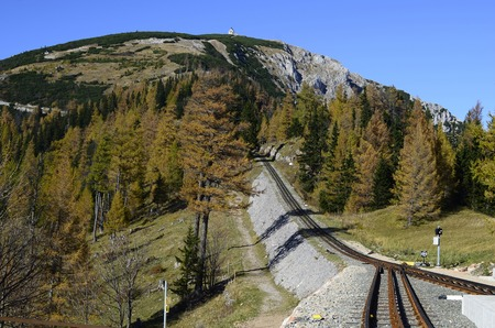 schneeberg: Austria, rails of the rack railway to Schneeberg-Mountain with remembrance chapel for Habsburg Kaiserin Elisabeth - aka Sissi Stock Photo