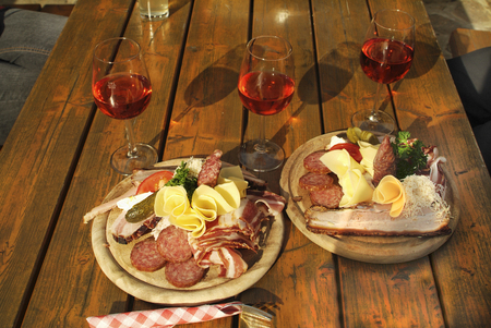 chees: Austria, typical snack named Brettljause with chees, ham,sausage and Schilcher wine