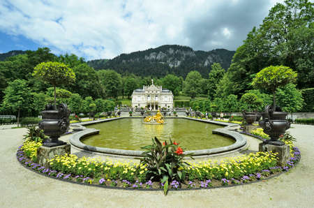 ii: Linderhof, Germany - June 27th 2014: Unidentified tourists visite Linderhof palace in Bavaria one of the castles of former king  Ludwig II
