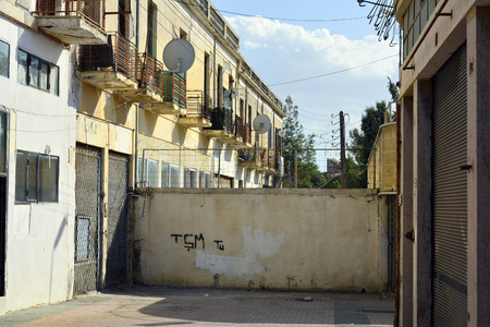 shared: Cyprus, blocked street and barb wired fence in the shared city Nicosia Stock Photo