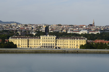 Vienna, Austria - September 17th 2012: Schnbrunn Palace was a residence of Habsburg monarchs and connected with different stories of Empress Elisabeth - Sissi - and a major tourist attraction. In background left the church on Leopoldsberg and right the Mu