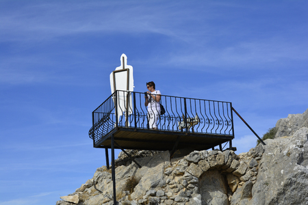 hilarion: Cyprus, woman on viewing platform on top of medieval ruins of Saint Hilarion castle near Kyrenia aka Girne Editorial