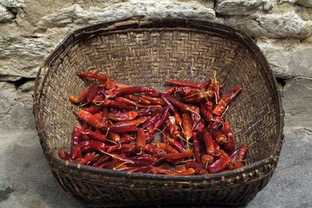 Bhutan: Bhutan, basket with chili Stock Photo