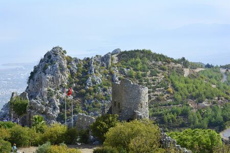 hilarion: Kyrenia, Cyprus - October 17th 2015: Unidentified tourists by sightseeing of impressive medieval fortress of St. Hilarion