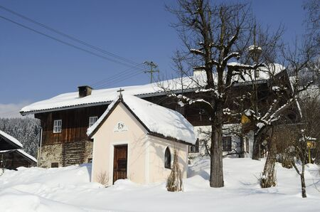 catholism: Austria, small capel and farmstead in traditional architecture in Tyrol