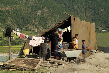 poorly: Punakha, Bhutan - September 23rd, 2007: Unidentified Nepalese immigrants in poorly home