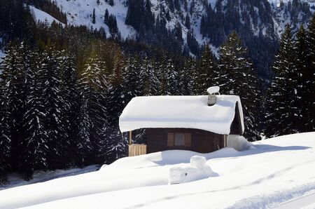 mountain hut: Hinterglemm, Austria - February 18th 2013: Small mountain hut - chalet in the Austrian alps covered with snow