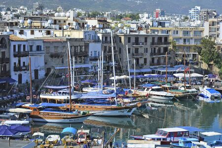 preferred: Kyrenia, Cyprus - October 17th 2015: Harbor of the city with different boats, hotels and restaurants, preferred place for tourists Editorial