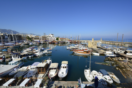 preferred: Kyrenia, Cyprus - October 17th 2015: Harbor of the city with different boats and promenade with restaurants, preferred place for tourists
