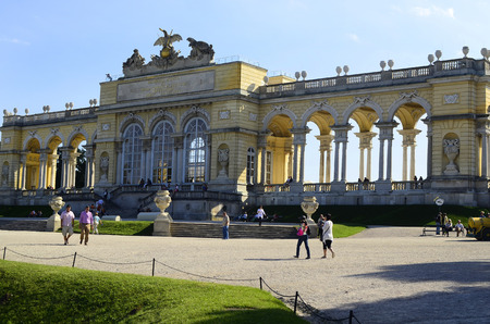 schoenbrunn: Vienna, Austria - September 17th 2012: Tourist attraction Gloriette, the baroque Unesco World Heritage building in the Schoenbrunn garden used as cafe and viewing point