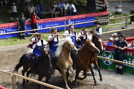 Siusi, Italy - June 16th 2013: Unidentified actors and spectators by horse-riding event named Oswald von Wolkenstein Ride, this traditional horseback riding tournament is held every year in South Tyrol around Castelrotto Castelrotto village and a wellkn