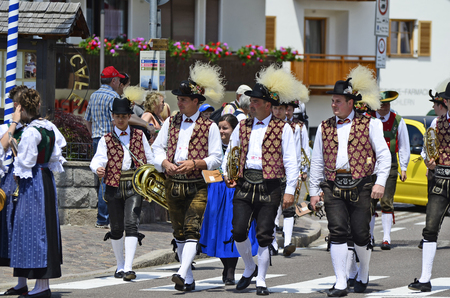 Castelrotto, Italy - June 15th 2013: Unidentified people and music group in tradtional clothing by yearly event named Oswald von Wolkenstein Ritt in the village in South Tyrol Editorial