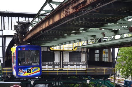 mode: Wuppertal, Germany - May 27th 2011: Overhead monorail on track, a traditional public mode of transport in the city