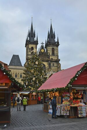 tyn: Prague, Czech Republic - December 2nd 2015: Unidentified people on Christmas market on old town square and Tyn church