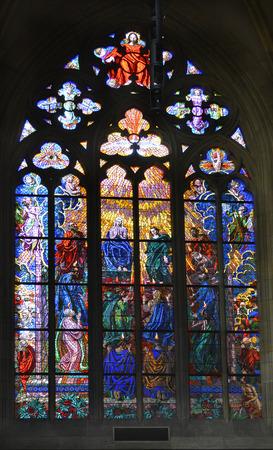 vitus: Prague, Czech Republic - December 3rd 2015: Arful painted window in Saint Vitus cathedral