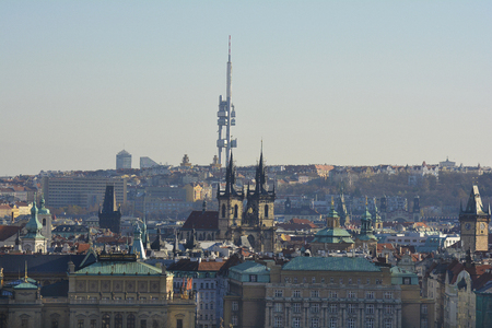 city scape: Prague, Czech Republic - city scape with Tayn church aka church of our Lady before tyn and TV tower in background Stock Photo