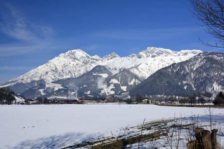 lumber mill: Austria, Leoganger Steinberge and timber mill in winter landscape