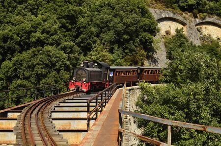 thessaly: Greece, the Montzouris-Smudgy train - Pelion train - crossing a bridge