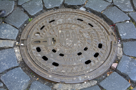 sewerage: Prague, Czech Republic - December 3rd 2015: Manhole cover with municipal coat of arms in the old part of Prague