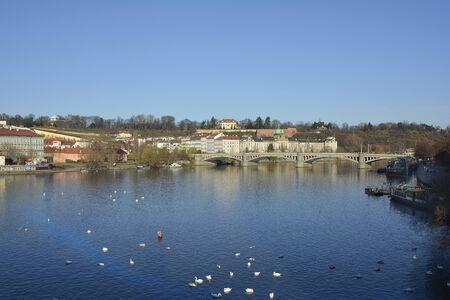 most: Prague, Czech Republic - Moldau river, buildings and bridge Manesuv Most