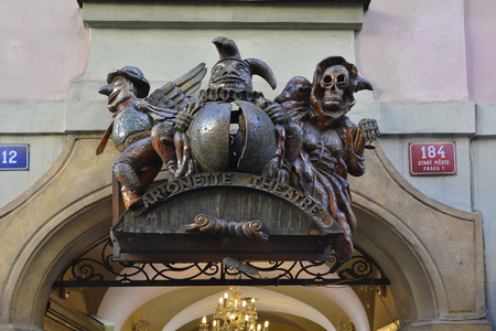 stare mesto: Prague, Czech Republic - December 3rd 2015: Sculptures on entrance to traditional marionette theater in old district Stare Mesto