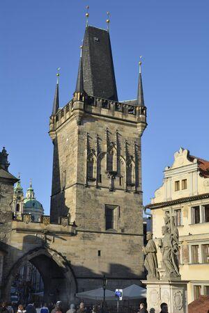 most: Prague, Czech Republic - December 3rd 2015: Sculpture on Charles bridge aka Karluv Most  and church tower