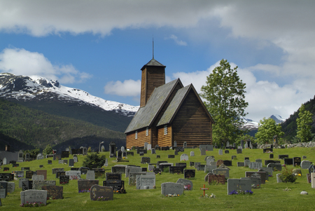luster: Luster, Norway - June 13th 2009: Cementary and wooden church in Sogn og Fjordanje