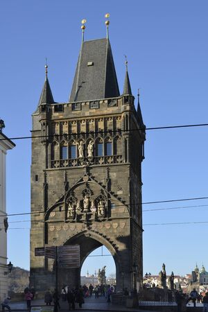 most: Prague, Czech Republic - December 3rd 2015: Unidentified people on tower to Charles bridge aka Karluv Most over river Moldau