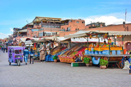 food shop: Marrakesh, Morocco - November 22nd 2014: Unidentified people and kiosks on Djemaa el-Fna, tourist attraction and Unesco World Heritage site