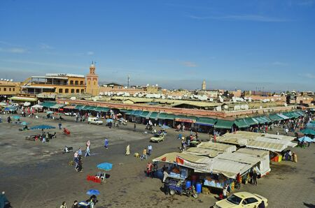 tourist attraction: Marrakesh, Morocco - November 23nd 2014: Unidentified people on Djemaa el-Fna, a preferred tourist attraction and Unesco world heritage site