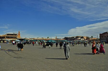 preferred: Marrakesh, Morocco - November 23nd 2014: Unidentified people on Djemaa el-Fna, a preferred tourist attraction and Unesco world heritage site