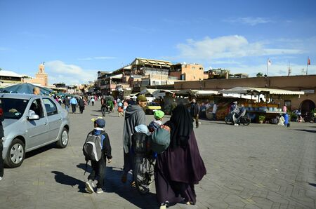 caftan: Marrakesh, Morocco - November 22nd 2014: Unidentified people and shops on Djemaa Elfna, tourist attraction and UNESCO World Heritage Site