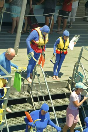 great barrier reef: Great Barrier Reef, Australia, March 2nd 2005: unidentified people in protective clothing on a platform in the coral sea