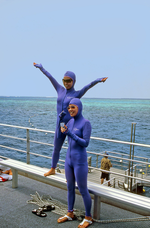 barrier reef: Australia, Queensland - March 2nd 2005: Two unidentified young Japanese women in protective clothing on barrier reef