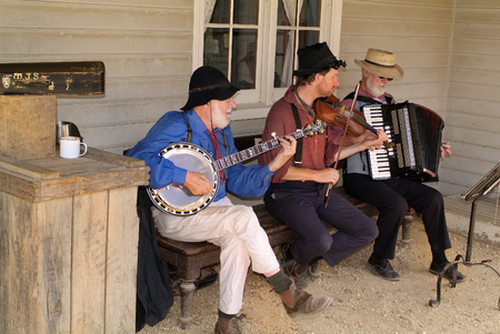 tourist attraction: Ballarat, Australia - January 23rd 2008: Unidentified musicians on Sovereign Hill, rebuilt gold digger village and preferred tourist attraction Editorial
