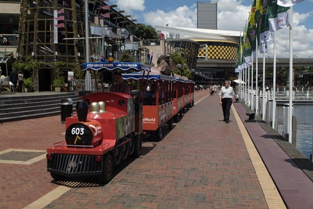 darling: Sydney, Australia - February 12th 2008: tourist tour train and restaurants in Darling Harbour Editorial