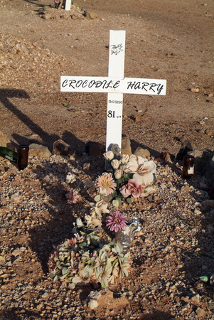 dugout: Coober Pedy, Australia - April 13th 2010: Grave of Crocodile Harry, at adventouros one and unique person in Coober Pedy - his dugout home is a tourist attraction