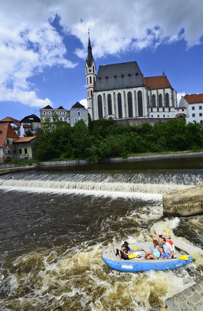unesco in czech republic: Cesky Krumlov, Czechia - August 11th 2013: Unidentified people in rubber raft and canoes on Moldau river in the Unesco World Heritage site in Bohemia, rafting is a preferred sport on this part of river Moldau Editorial