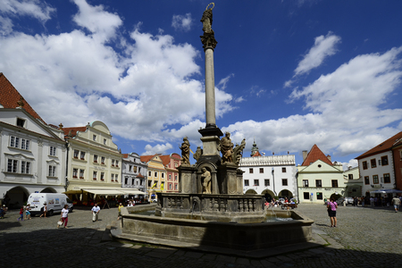 unesco in czech republic: Cesky Krumlov, Czechia - August 11th 2013: Unidentified tourists, restaurants, fountain and buildings around the maket square in the Unesco World Heritage site in Bohemia